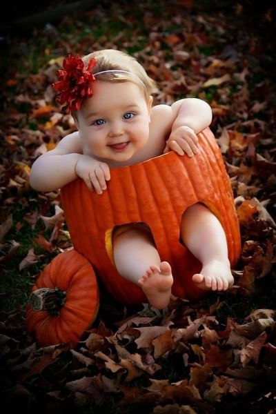 Cute Baby Enjoying Halloween in a Sliding Pumokin